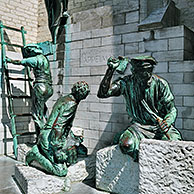 Sculpture group showing medieval labourers and stone carvers in front of the Cathedral of Our Lady in Antwerp, Belgium