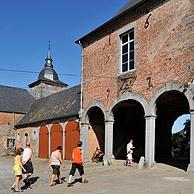 Tourists visiting the castle farm at Falaen in the Ardennes, Belgium
