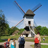 Tourists in front of windmill in the open air museum Bokrijk, Belgium