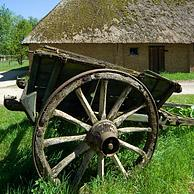 Old wooden cart in front of barn in the open air museum Bokrijk, Genk