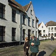 Tourists in the beguinage in Bruges, Belgium