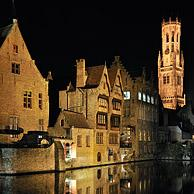 Belfry and mediaeval houses along the canals of Bruges, Belgium