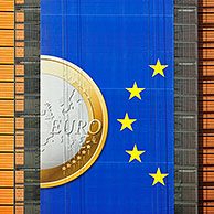 Banner about the euro hanging from the Berlaymont building of the European Commission, executive body of the European Union, Brussels, Belgium