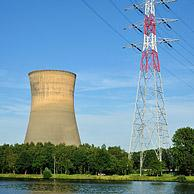 High voltage pylon and cooling tower of the Electrabel power station along the Ghent-Terneuzen Canal at Ghent seaport, Belgium