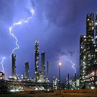 Lightning during thunderstorm above petrochemical industry in the Antwerp harbour, Belgium