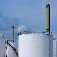 Storage tanks of oil refinery from the petrochemical industry of the Antwerp harbour, Belgium