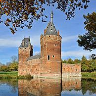The medieval Beersel Castle reflected in moat, Belgium