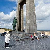 Tourists at the statue of Leopold I at the Esplanade, De Panne, Belgium