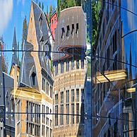 Reflection in glass façade of the historical buildings at the Cour des Mineurs, Liège, Belgium