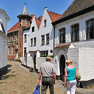 Tourists visiting the Saint Elisabeth Beguinage with its small houses built in the 17th century, Kortrijk, Belgium