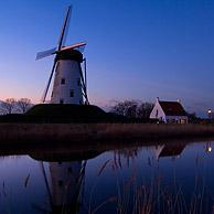 The windmill Schellemolen along the Damme Canal at night, Damme, Belgium