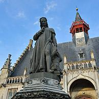 Statue of Jacob van Maerlant in front of the town hall at Damme, Belgium