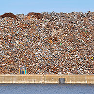 Scrap heap along the Ghent-Terneuzen Canal at Ghent seaport, Belgium