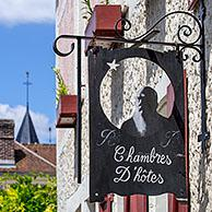 Sign showing silhouette of Impressionist painter Claude Monet at Le Coin des Artistes, chambre d'hotes at Giverny, Eure department, Normandy, France