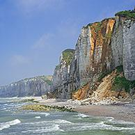 Shingle beach and chalk cliffs along the North Sea coast at Yport, Normandy, Seine-Maritime, France
