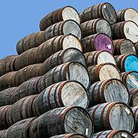 Huge stacks of discarded whisky casks / barrels at Speyside Cooperage, Craigellachie, Aberlour, Banffshire, Grampian, Scotland, UK
