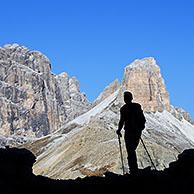 Mountain walker silhouetted against Torre dei Scarperi / Schwabenalpenkopf, Sexten Dolomites, Parco Naturale Tre Cime, South Tyrol, Italy