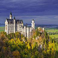 Neuschwanstein Castle seen from Marienbrücke in autumn / fall, 19th-century Romanesque Revival palace at Hohenschwangau, Bavaria, Germany