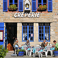 Tourists on terrace eating crepes at crêperie in Paimpol, Côtes-d'Armor, Brittany, France <BR><BR>More images at www.arterra.be</P>