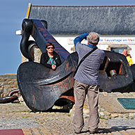 Tourists posing at the anchor of the Amoco Cadiz oil tanker, wrecked in March 1978 at Portsall, Brittany, France <BR><BR>More images at www.arterra.be</P>