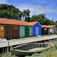 Colourful cabins of oyster farm near Dolus / Saint-Pierre-d'Oléron on the island Ile d'Oléron, Charente-Maritime, France