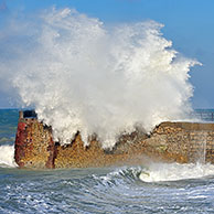 Waves crashing into jetty during storm at Saint-Valéry-en-Caux, Normandy, France <BR><BR>More images at www.arterra.be</P>