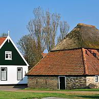 Traditional house and barn in the village Den Hoorn, Texel, the Netherlands