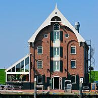 The historical warehouse / storehouse / entrepôt is now a fish restaurant in the harbour of Oudeschild, Texel, the Netherlands