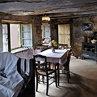 Interior of troglodyte house in rock face at Graufthal, Vosges, Alsace, France