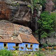 The blue troglodyte houses in rock face at Graufthal, Vosges, Alsace, France <BR><BR>More images at www.arterra.be</P>